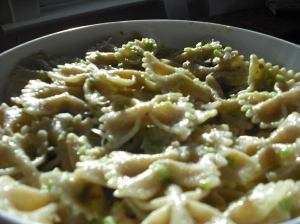 photo of sunlight glimmering off the gorgeous green pesto tossed in pasta