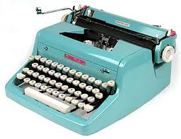 blue portable typewriter