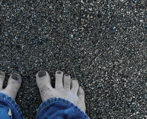 Image of bare feet on the beach